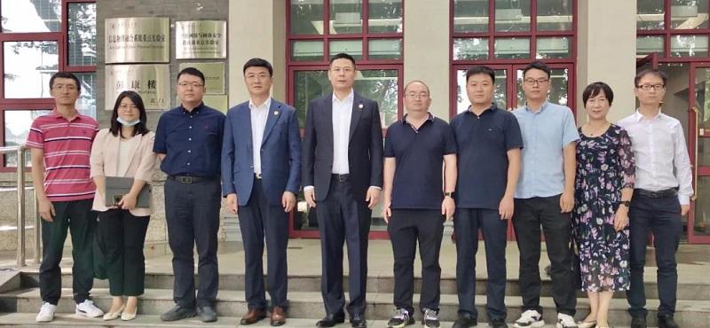 和数集团董事长唐毅先生一行到访西安交通大学